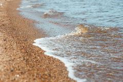 Beach sand and sea water Stock Photo