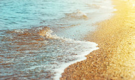 Beach sand and sea water. In sunny day Royalty Free Stock Image