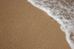Beach sand and sea water Royalty Free Stock Photo