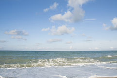Beach. The Sand, Splashing Waves, Beach, Blue Sky And Clouds Stock Image