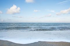 Beach. The Sand, Splashing Waves, Beach, Blue Sky And Clouds Royalty Free Stock Photo