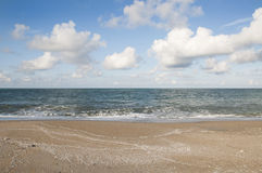 Beach. The Sand, Splashing Waves, Beach, Blue Sky And Clouds Royalty Free Stock Photography