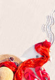 Beach. Sand texture - flip flop sandals, hat, sarong, sunglasses. Stock Photos