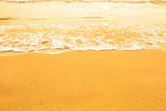 Beach sand texture, soft wave of the sea. Color. Purity. Stock Photos