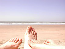 Beach sand toes Stock Photography