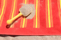 Beach sand on towel Royalty Free Stock Photography