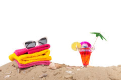 Beach sand with towels and cocktail Stock Photo