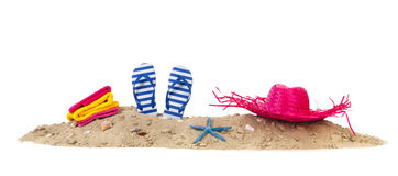 Beach sand with towels flip flops and hat. Beach with towels, flip flops and summer hat Stock Photography