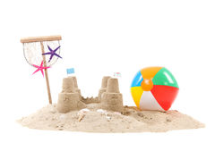 Beach with sand and toys. Beach with sand, fishing net and toys isolated over white background stock images