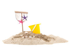 Beach with sand and toys. Beach with sand, fishing net and toys isolated over white background royalty free stock photos