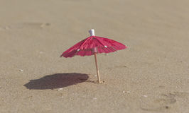 Beach sand and umbrella for cocktails Stock Images
