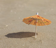 Beach sand and umbrella for cocktails Stock Image