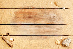 Beach sand on vintage planked wood background Stock Photography