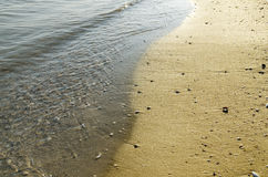 Beach with sand and water Stock Photography