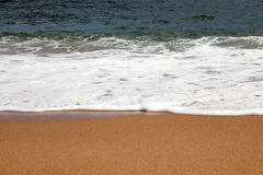 Beach sand and wave Stock Image