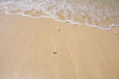 Beach sand and wave royalty free stock photo