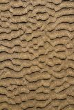 Beach sand waves pattern texture brown wet Stock Photo
