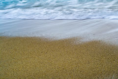Beach sand and waves Royalty Free Stock Images