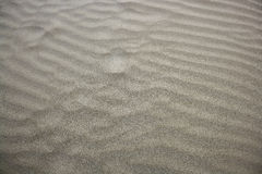 Beach sand waves warm texture background Royalty Free Stock Photos