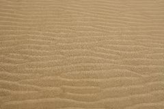 Beach sand waves warm texture background Royalty Free Stock Photography