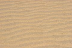 Beach Sand. Wavy tan beige beach sand for backgrounds royalty free stock photography