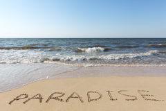 Beach with sand word paradise Royalty Free Stock Photo