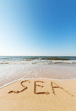Beach with sand word sea Stock Image
