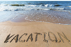 Beach with sand word vacation Stock Photography
