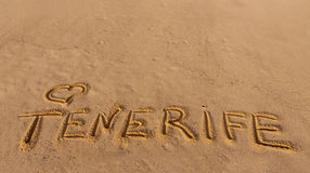 Beach sand with written word Tenerife Stock Photo