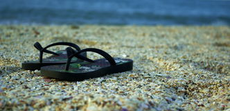 Beach and sandals Royalty Free Stock Image