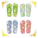 Beach sandals. Colorful flip-flops over white background. Colorful flip-flops over white background Stock Photography