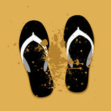Beach sandals on sand Stock Images