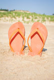 BEACH SANDALS IN SAND stock photo