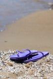 Beach sandals  on a sandy beach Royalty Free Stock Photos