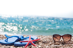 Beach sandals starfish and sunglasses Stock Photos