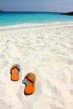 Beach sandals on white sand Royalty Free Stock Photos