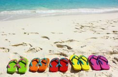 Beach sandals on white sand Royalty Free Stock Photo