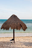 Beach Sandles Under Thatched Umbrella Royalty Free Stock Photos