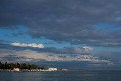 A beach and a sandy beach i. N the evening in Evpatoria, in Crimea Royalty Free Stock Photo