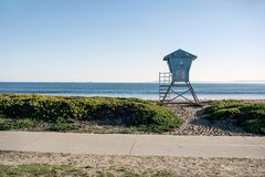 Beach of Santa Barbara. Blue rescue tower on the ocean beach on the clear sky background in Santa Barbara in California USA. Horizontal Royalty Free Stock Photos