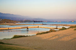 Beach in Santa Barbara with rusty pipelines Stock Photos