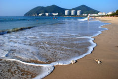 Beach of the Sanya,Hainan Province,China. Beautiful sunny beach of the Sanya,Hainan Province,China.The sea water is very clear and clean, and the breeze warm Stock Photo