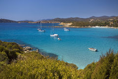 Beach of Sardinia. Calm sea with sailing boats moored in the south of Sardinia Stock Image