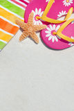 Beach Scene. Towel, sandals and starfish at beach Stock Images