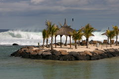 Beach scene. With crashing waves and beach furniture in Mauritius Stock Photos