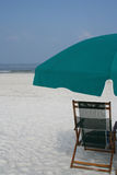Beach scene. Chair and beach umbrella Royalty Free Stock Photography