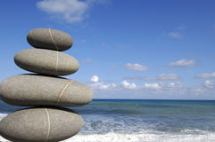 Beach Scene. Stack of stones on beach, sea and sky Stock Image