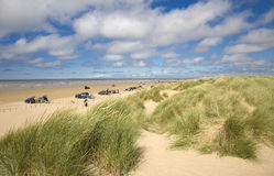 Beach scene. Sunny summer day beach scene with sand dunes - Ainsdale on Sea, Sefton Coast, UK Royalty Free Stock Images