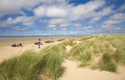 Beach scene. Sunny summer day beach scene with sand dunes - Ainsdale on Sea, Sefton Coast, UK royalty free stock images