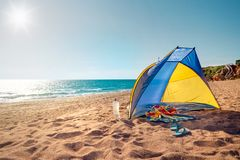Beach scene with a beach tent Stock Images